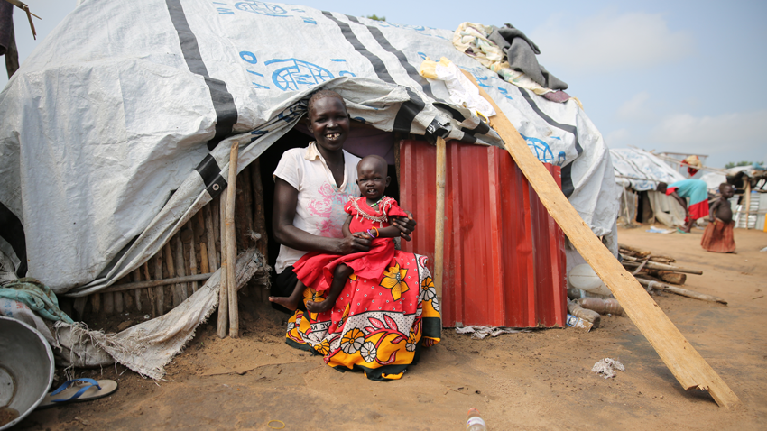 Elizabeth with her youngest daughter in front of her shelter